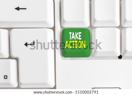 Conceptual hand writing showing Take Action. Business photo text Supporting what you say not just words but through evidence White pc keyboard with note paper above the white background. #1510002791