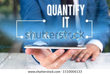 Word writing text Quantify It. Business concept for Measure the size or amount of something and express in numbers Male human wear formal work suit presenting presentation using smart device. #1510006133