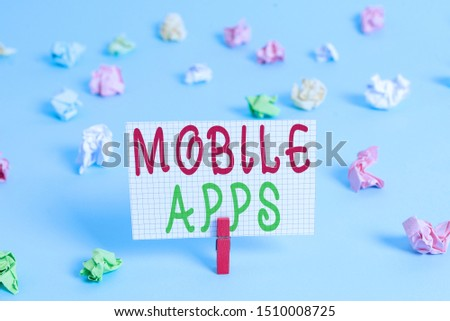 Conceptual hand writing showing Mobile Apps. Business photo showcasing small programs are made to work on phones like app store or app store Colored clothespin rectangle shaped paper blue background. #1510008725