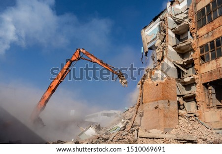 dismantling of the old building, excavator for demolition of the house Royalty-Free Stock Photo #1510069691