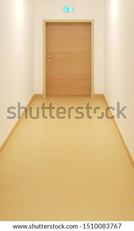 empty floor with emergency exit door and sign #1510083767