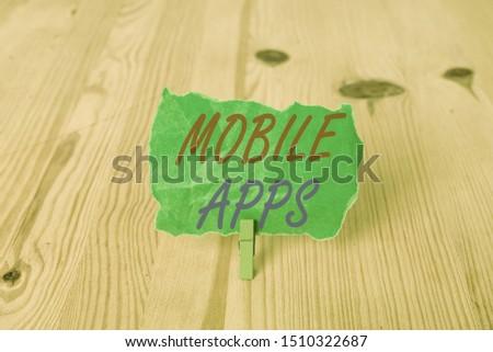 Text sign showing Mobile Apps. Conceptual photo small programs are made to work on phones like app store or app store Empty reminder wooden floor background green clothespin groove slot office. #1510322687