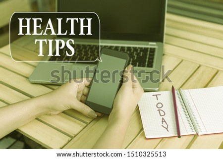 Word writing text Health Tips. Business concept for state of complete physical mental and social well being woman laptop computer smartphone office supplies technological devices. #1510325513