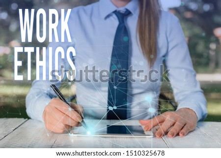 Conceptual hand writing showing Work Ethics. Business photo showcasing A set of values centered on the importance of doing work Female human wear formal work suit presenting smart device. #1510325678