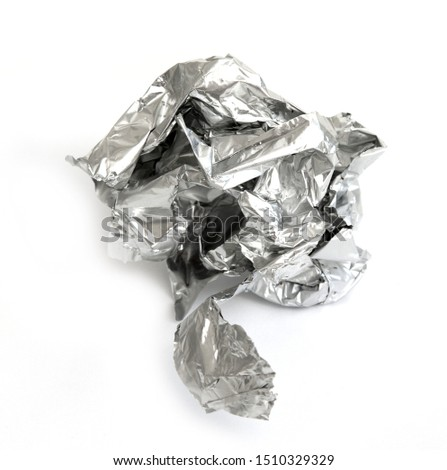 Crumpled confectionery foil on a white background. #1510329329