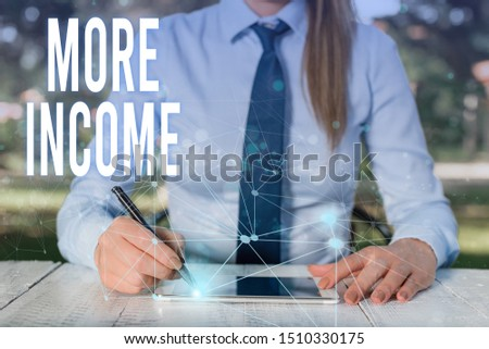 Conceptual hand writing showing More Income. Business photo showcasing Additional money receives for an exchange of good or services Female human wear formal work suit presenting smart device. #1510330175