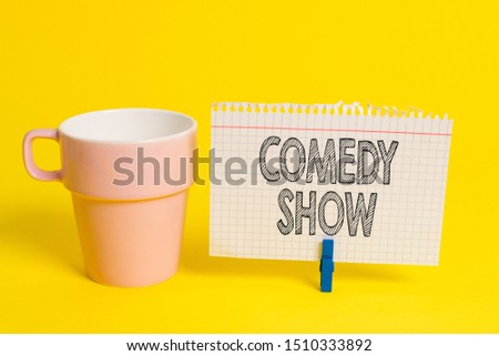 Writing note showing Comedy Show. Business photo showcasing Funny program Humorous Amusing medium of Entertainment Cup empty paper blue clothespin rectangle shaped reminder yellow office. #1510333892