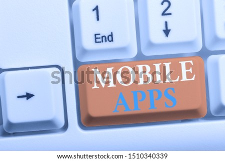 Writing note showing Mobile Apps. Business photo showcasing small programs are made to work on phones like app store or app store White pc keyboard with note paper above the white background. #1510340339