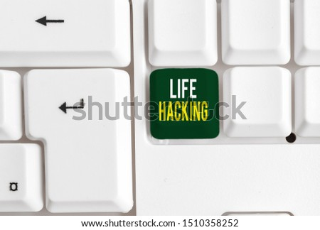 Conceptual hand writing showing Life Hacking. Business photo showcasing Simple and clever techniques in accomplishing task easily White pc keyboard with note paper above the white background. #1510358252