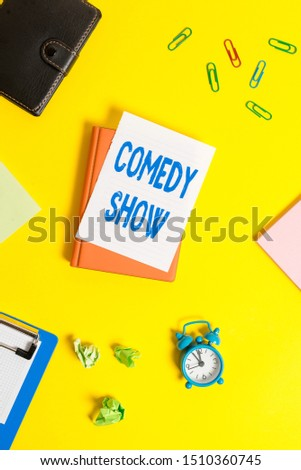Text sign showing Comedy Show. Conceptual photo Funny program Humorous Amusing medium of Entertainment Pile of empty papers with copy space on the table. #1510360745