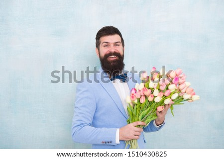 Birthday greetings. Best flowers for girlfriend. Flowers for her. Man bearded suit bow tie hold tulips bouquet. Gentleman making romantic surprise for her. Flowers delivery. Gentleman romantic date. #1510430825
