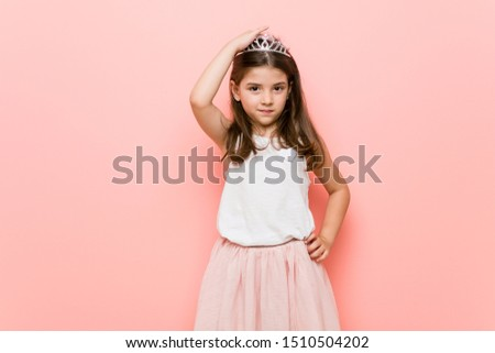 Little girl wearing a princess look being shocked, she has remembered important meeting. #1510504202