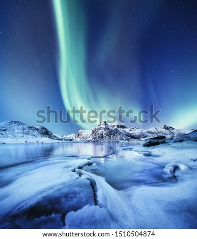 Aurora Borealis, Lofoten islands, Norway. Nothen light and reflection on the lake surface. Winter landscape at the night time. Norway travel - image #1510504874