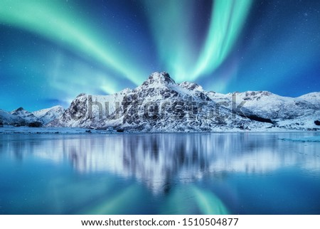 Aurora Borealis, Lofoten islands, Norway. Nothen light and reflection on the lake surface. Winter landscape at the night time. Norway travel - image #1510504877