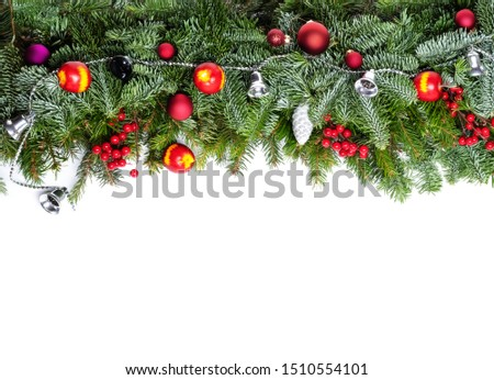 Christmas decorative background border with red bauble decorations, holly berries, spruce and pine cones #1510554101