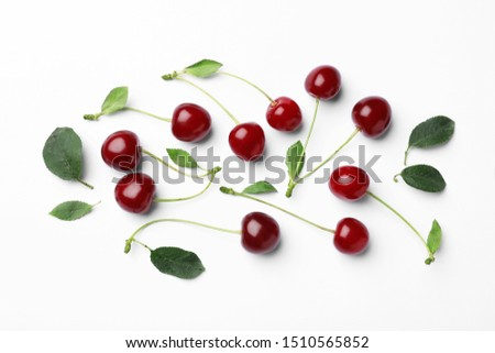 Tasty ripe cherries with leaves on white background, top view #1510565852