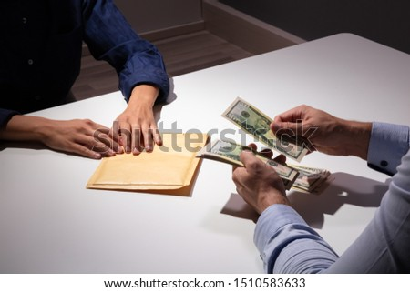 Businessman Counting The New Us Dollars Paper Money Received In Form Of Bribe #1510583633