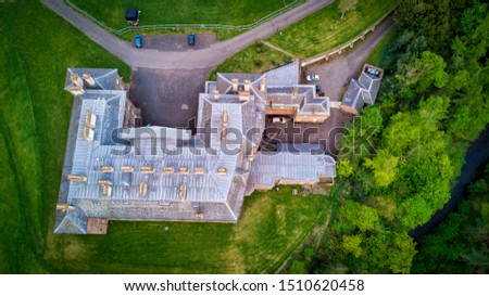 Aerial view of Dalkeith Palace amidst green fields and trees- directly from above #1510620458