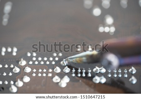 Soldering with a soldering iron on a chip #1510647215