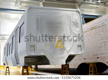 Inside of the rail car assembly plant. Industrial workshop for the production of high speed trains. Factory of the manufacturing trainsets passenger rolling stock. Paint shop #1510671206