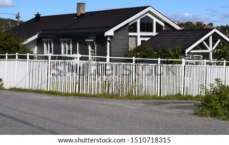 Beautiful grey gray residence house exterior and facade with green garden in sunny and autumn season - Kongsvinger, Norway #1510718315