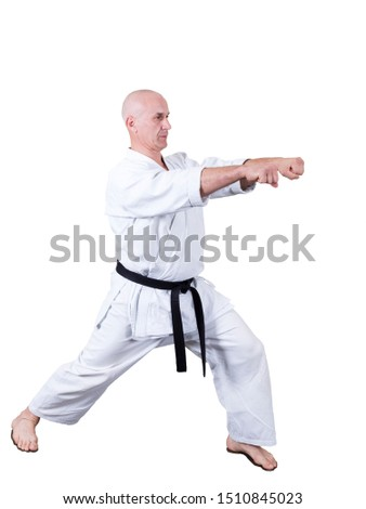Adult athlete performs formal goju-ryu exercises. It is isolated in a white background. Close-up. #1510845023