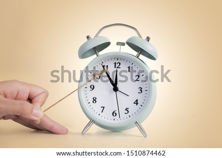 Time on alarm clock stop, delay concept. Royalty-Free Stock Photo #1510874462