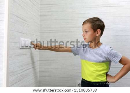 Child turns off the light at home #1510885739