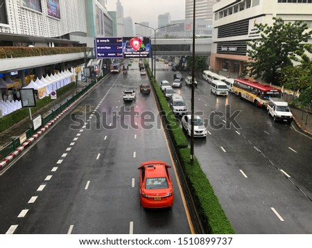 Bangkok, Thailand - Sep 21, 2019 : Soft raining on road at bangkok city.Little car on street in town. #1510899737