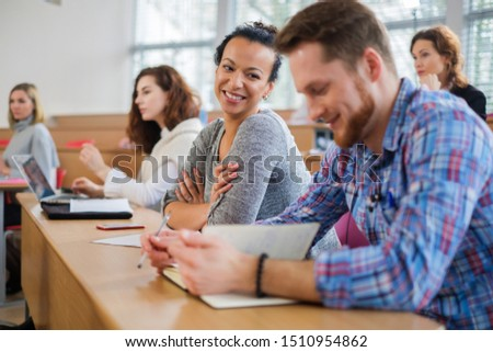 Multinational group of students in an auditorium #1510954862