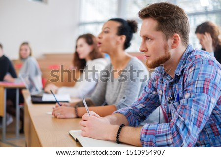 Multinational group of students in an auditorium #1510954907