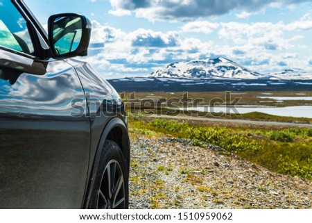 Black four-wheel drive car in the Swedish fell Mountains with Snowy Mountains in the background,Stekenjokk is an area of Stromsund Municipality in Jamtlands lan and Vilhelmina in Vasterbotten #1510959062