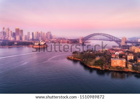 Major landmarks of Sydney city around Sydney harbour and Circular quay across from Kirribilli wealthy suburb on Lower North SHore at sunrise in aerial view. #1510989872