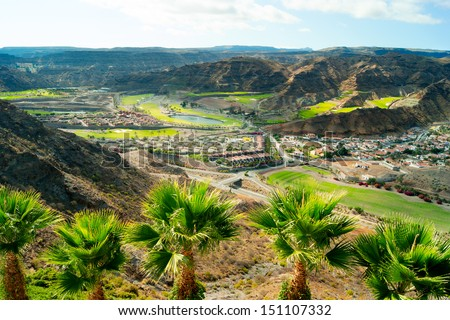 View over the mountains and villas in Puerto Rico, Gran Canaria Royalty-Free Stock Photo #151107332
