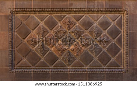 Elements of architectural decoration of buildings, stucco moldings, stucco wall texture, patterns and statues. On the streets in Catalonia, public places. #1511086925