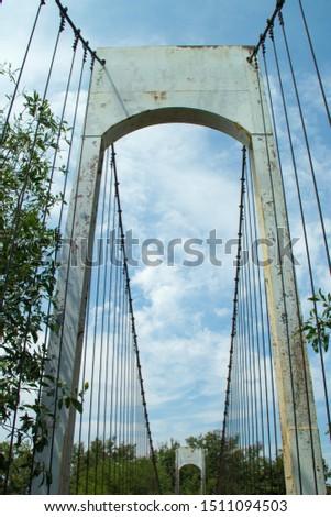 Ancient suspension bridge,Suspension bridge and blue sky. #1511094503