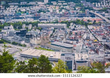 Bergen, Norway - july 18 2019: tourist look at the Scandinavian city of Bergen on a summer day  #1511126327