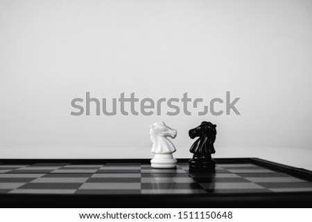 Black knight and White knight stand face to face. Business competition. competitiveness and strategy. #1511150648