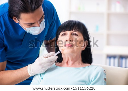 Old woman visiting male doctor for plastic surgery #1511156228
