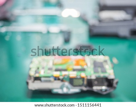 Blur image of workplace in laboratory with needed equipment and electronics device, Abstract blurred of Repair of electronic devices, Repairing and service concept. #1511156441