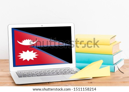Flag of Nepal on Laptop. Nepal Flag on Screen. #1511158214