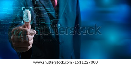 Fingerprint scan provides security access with biometrics identification.Businessman scan fingerprint biometric identity and approval.Business Technology Safety Internet Concept. Royalty-Free Stock Photo #1511227880