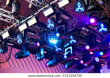 Set of professional stage lighting equipment for gig illumination.Floodlights,several powerful stage light,used to illuminate also sports field,stage,exterior of building.Stage illumination.SOFT FOCUS #1511246720