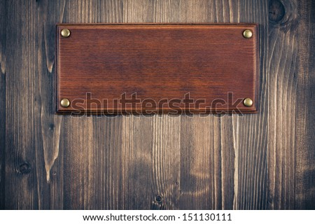 Wooden sign board blank frame on old wood background