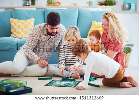 happy family playing board games together at home #1511312669