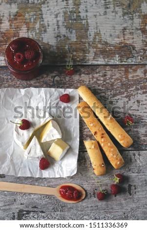 Camembert cheese with raspberry sauce. Macro. Selective focus. #1511336369