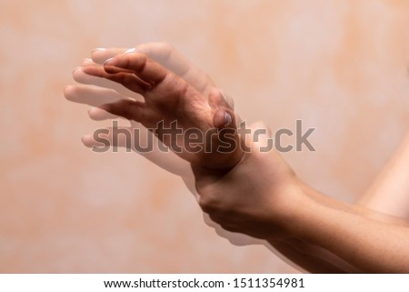 hands pain concept, closeup view and motion blur of left hand #1511354981