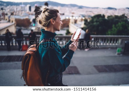 Cheerful hipster girl tracking gps via location app on cellular with copy space area for website for travelers, millennial smiling woman chatting via blank smartphone during Spanish vacations #1511414156