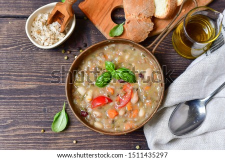 """Traditional Italian dish """"zuppa Toscana"""" from Tuscany ( Florence ) soup with different types of beans, carrots and vegetables. Vegan recipe. autumn winter food menu, food Italy.  Selective focus #1511435297"""