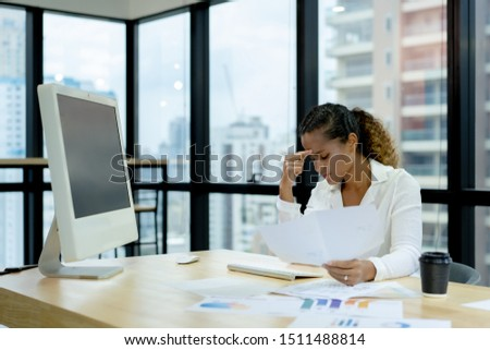 African american businesswoman frustrated by business problem and feeling unwell suffering from work stress sitting at the office desk #1511488814